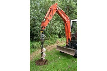 Excavator mounted post hole borer