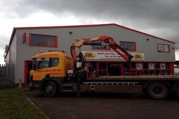 Plant lorry with cheesewedge body and hiab crane
